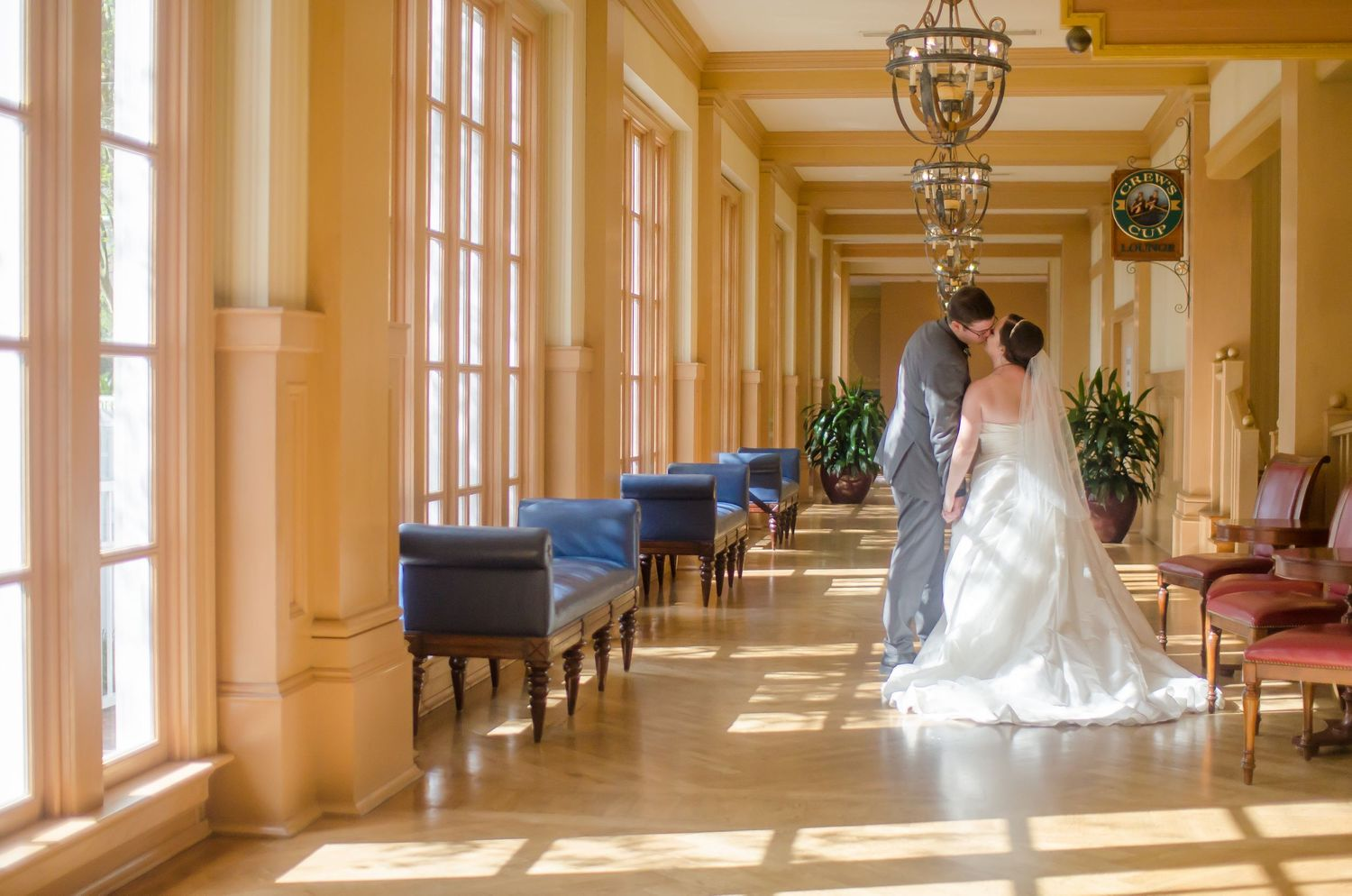 Bride and Groom kissing in the hallway on their way to their Walt Disney World Yacht Club resort wedding
