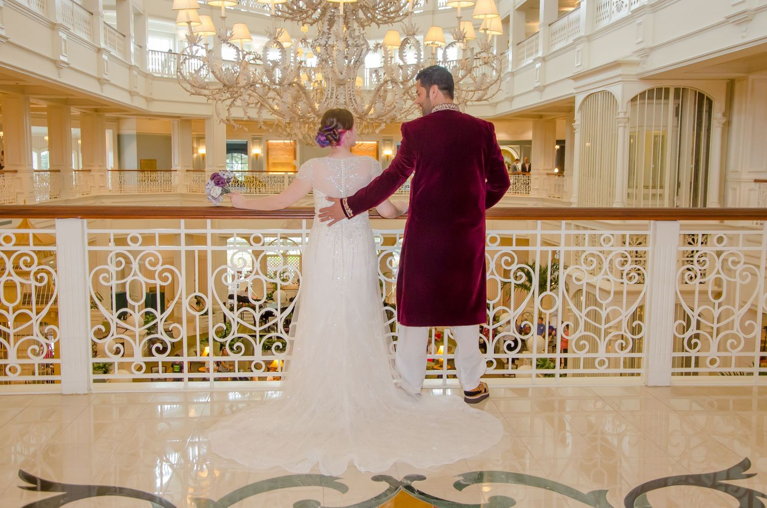 Bride and Groom with a chandelier at their Walt Disney World Grand Floridian wedding