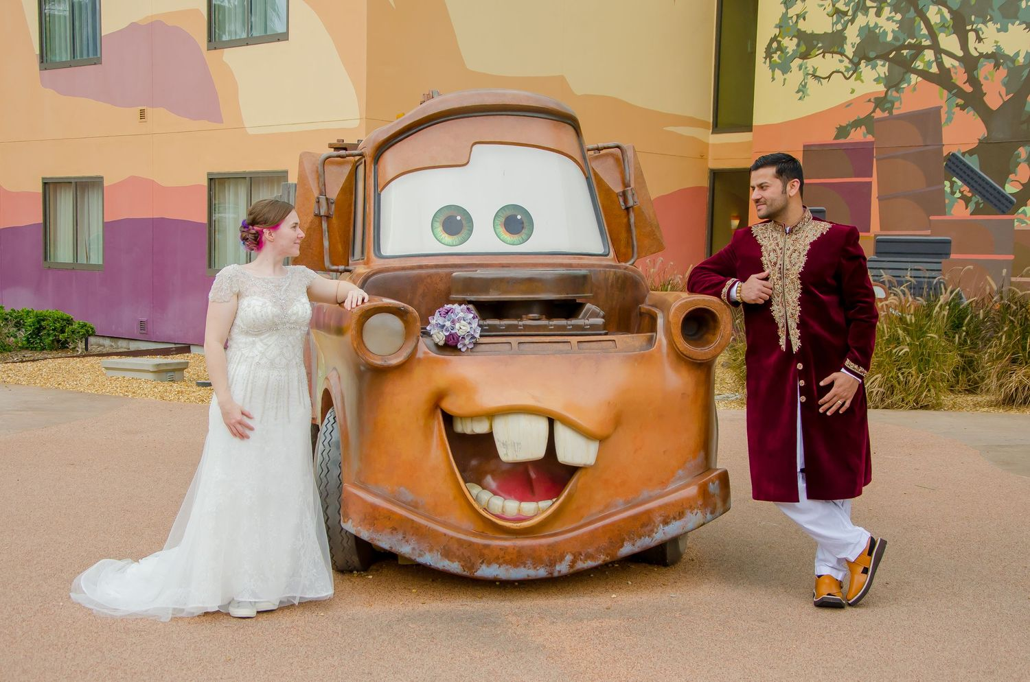 Bride and Groom with Tow Mater at their Walt Disney World Art of Animation Resort wedding