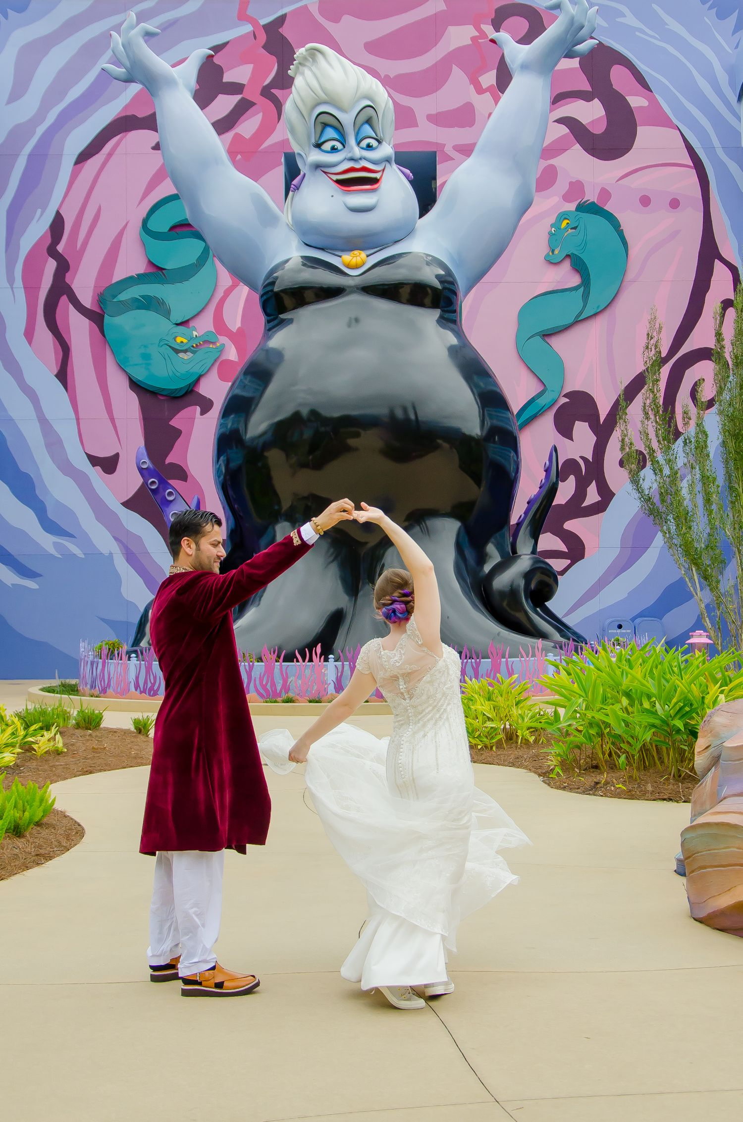 Bride and Groom dancing with Ursula at their Walt Disney World Art of Animation Resort wedding