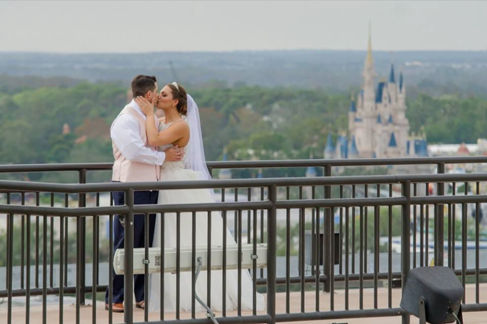Bride and Groom with Cinderella Castle at their Walt Disney World Magic Kingdom wedding