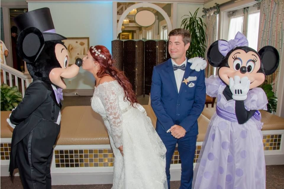 Bride and Groom with Mickey and Minnie at their Walt Disney World Beach Club Resort wedding