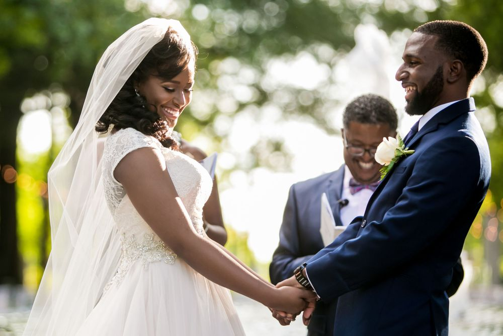Jamil'ya & Julian exchange vows during their wedding ceremony at the Lace House in Columbia, SC.  Photo by Jeff Blake