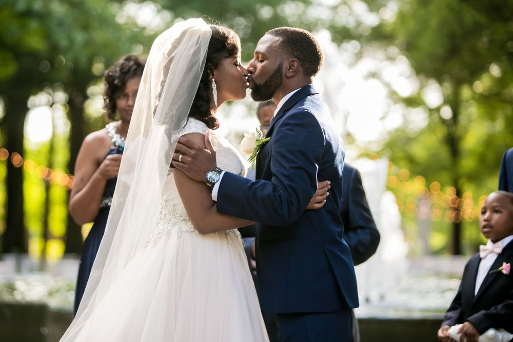 Jamil'ya & Julian kiss during their wedding ceremony at the Lace House in Columbia, SC.  Photo by Jeff Blake