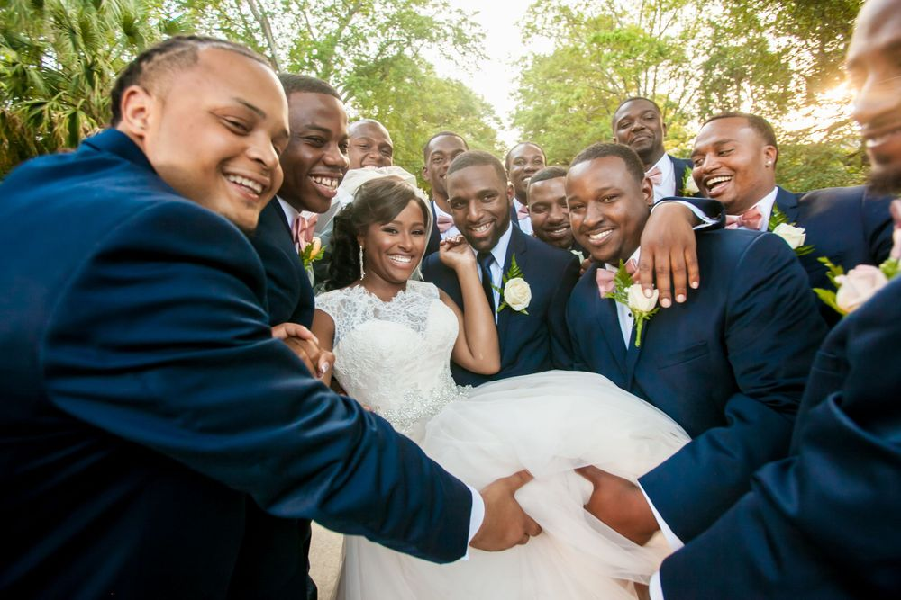 Bride Jamil'ya with her groomsmen following their wedding ceremony at the Lace House in Columbia, SC