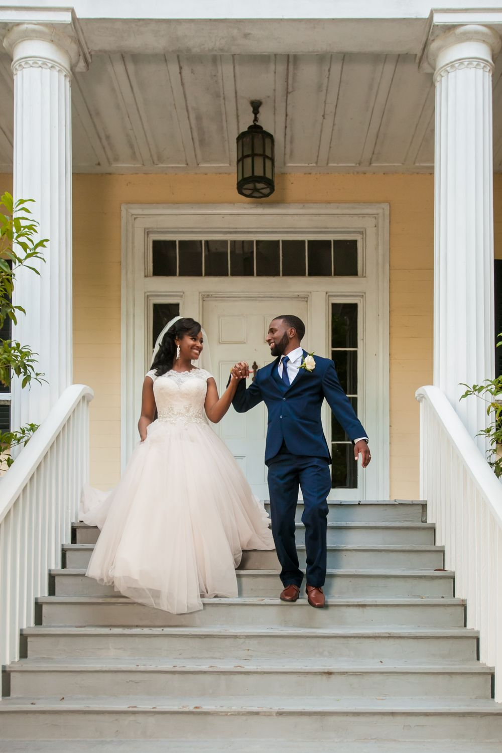 Bride Jamil'ya and groom Julian walk to their reception at the Lace House in Columbia, SC