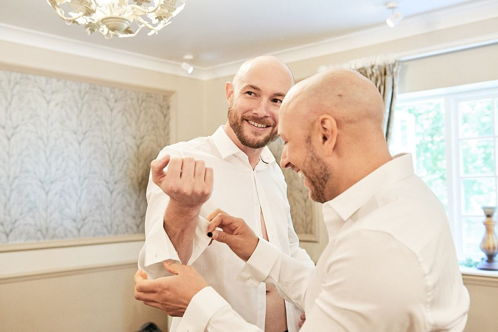 groom and groomsmen get ready at Lenwade House, Norwich. by Norwich wedding photographer Faye Amare