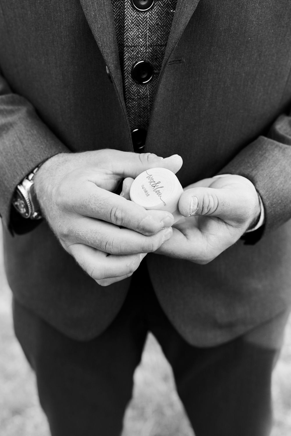 groom hold wedding ring box in hands before wedding at Old Buckingham, by Norfolk Wedding Photographer Faye Amare
