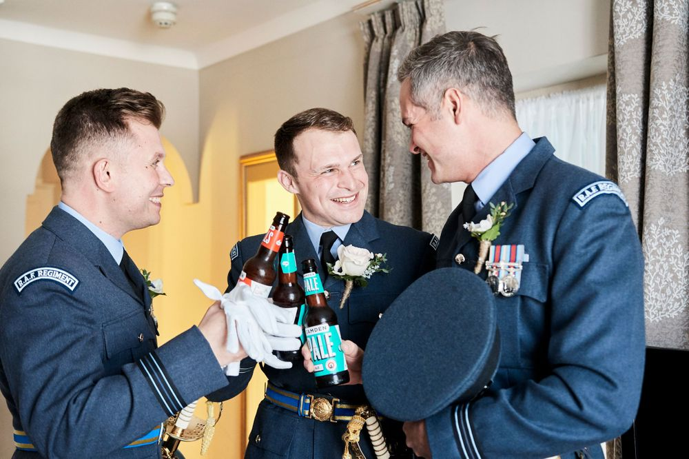 groom gets ready at The Angel, Suffolk. by Suffolk wedding photographer Faye Amare