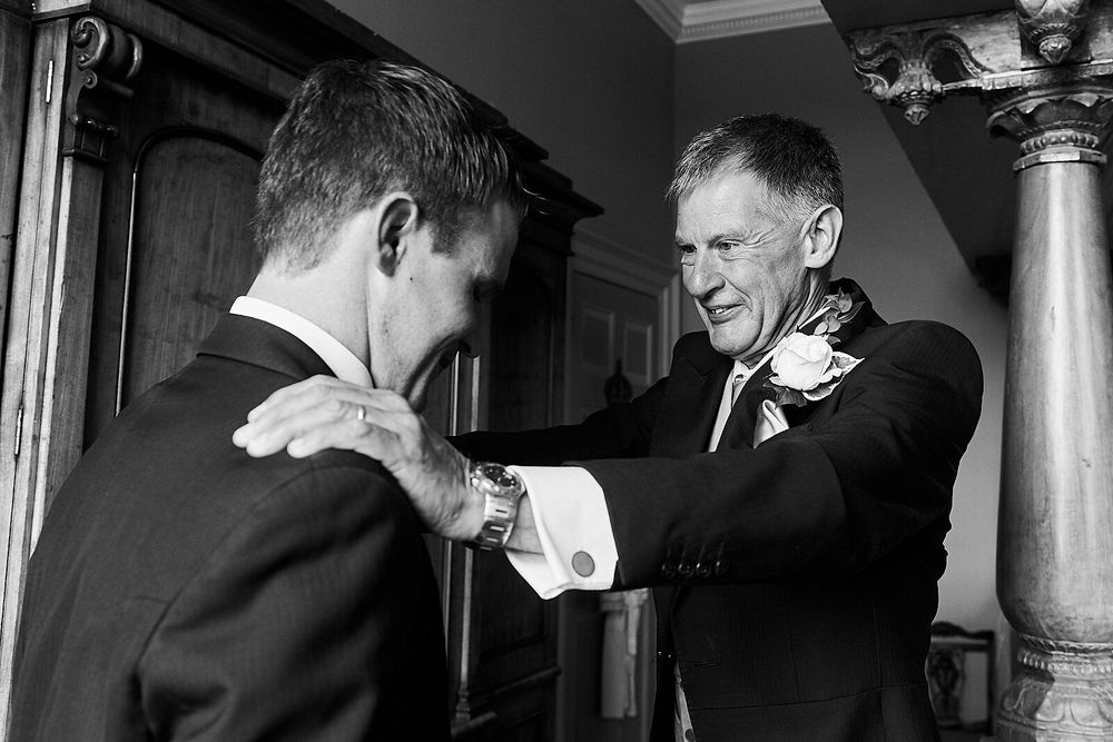 groom gets ready at Kimberly Hall, Norwich. by Norwich wedding photographer Faye Amare