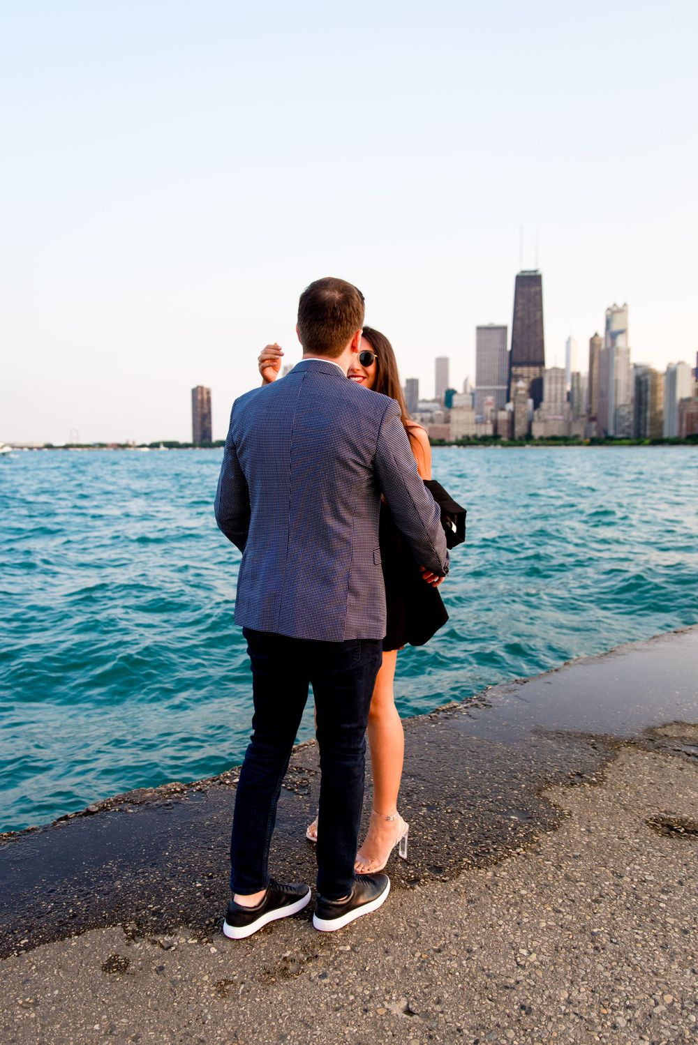 man going to hug woman after he proposed at North Avenue Beach pier
