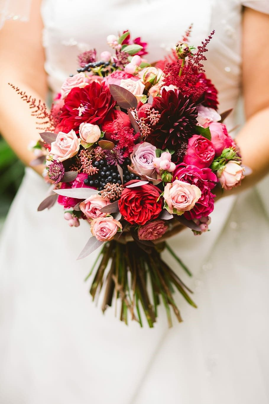 A woman holding wedding bouquet.