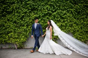 Dallas Wedding Photography | Bride and groom walking in the Dallas Arts District in downtown Dallas TX | Monica Salazar