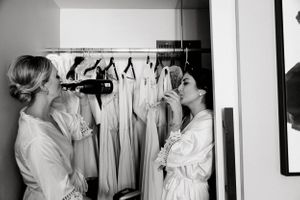 Wedding Photographers in Dallas TX | Bridesmaids candid black white photo drinking champagne | Statler Hotel Dallas