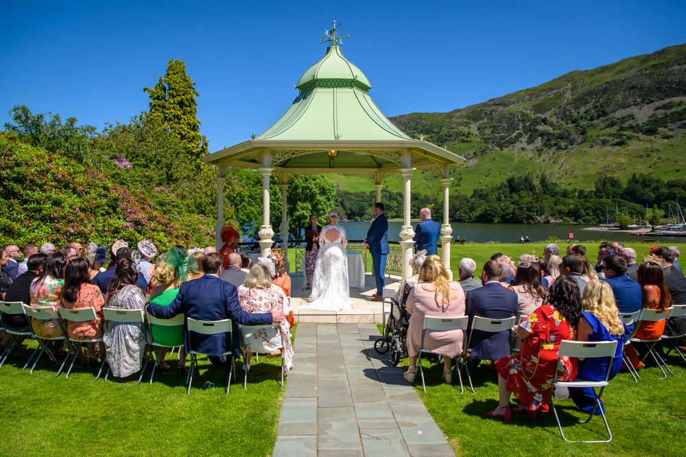 Outdoor ceremony under gazebo at Inn on the Lake