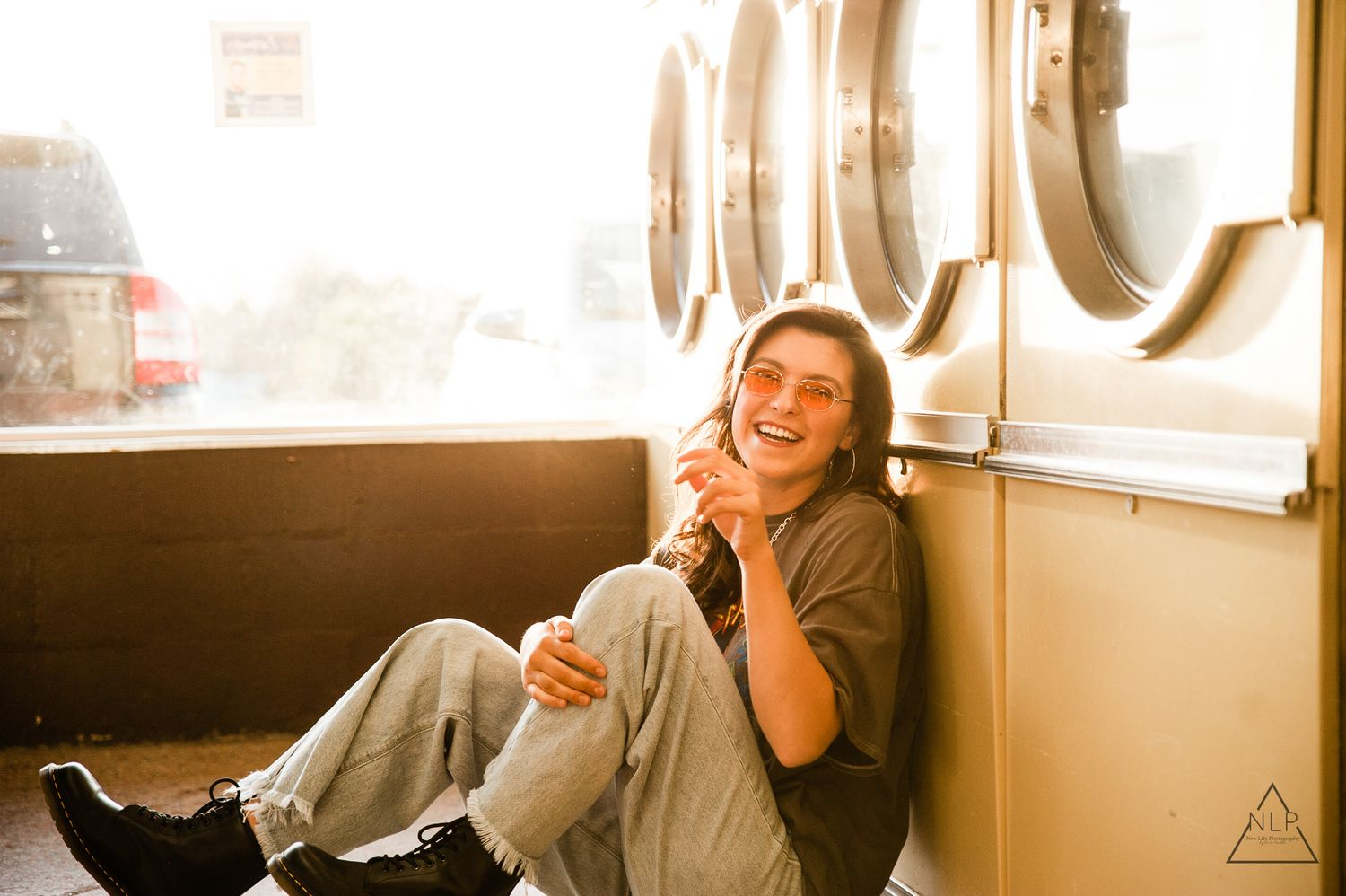 carefree highschool senior in laundry mat