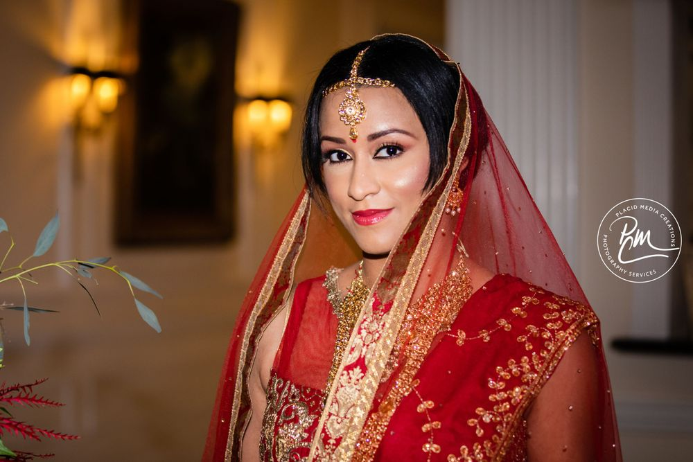 Indian Bride Saree shades of red are popular colors as they represent happiness and good luck to the married couple