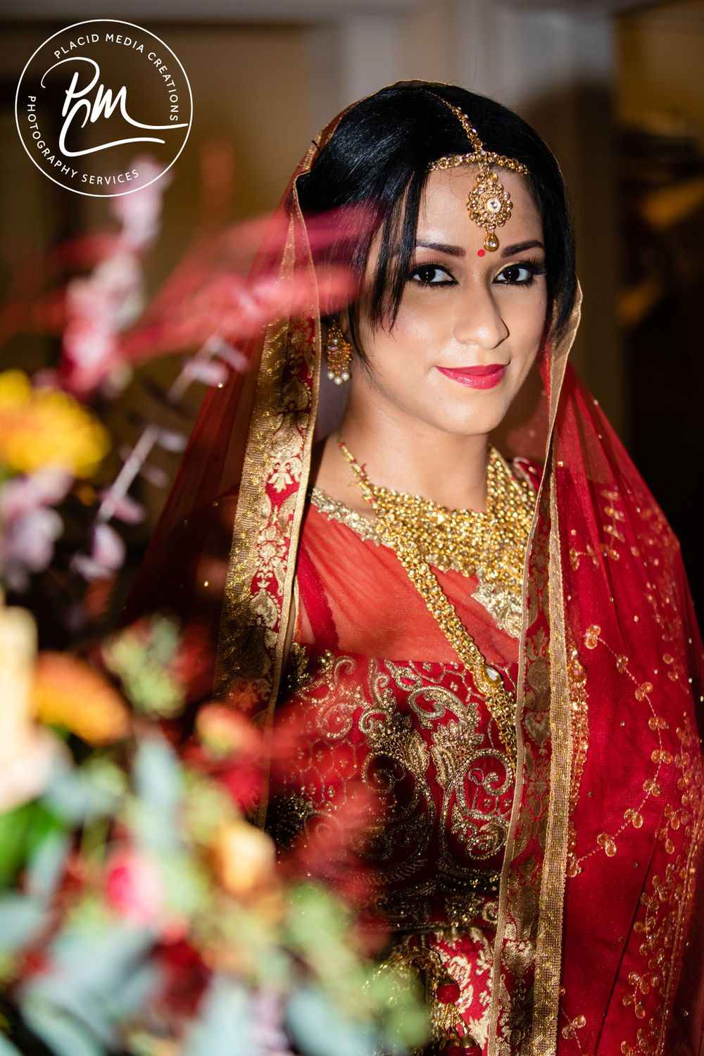 Bride wears colorful lehengas are embroidered with intricate gold designs