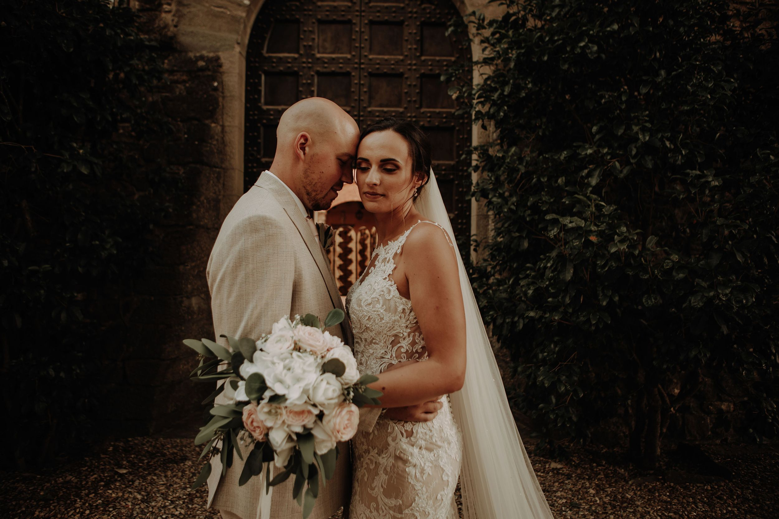Bride and groom photograph outdoors at Castelo Il Palagio destination italian wedding in Tuscany