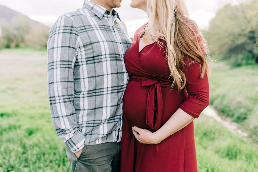 couples pose during maternity photo session in scottsdale, AZ