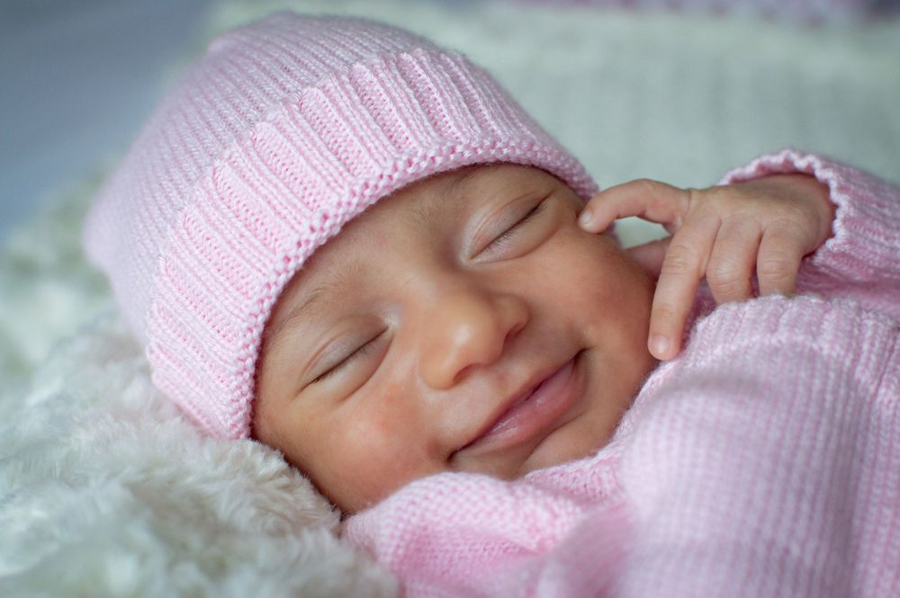 Cute baby girl smiling for her newborn photography photo session in tampa