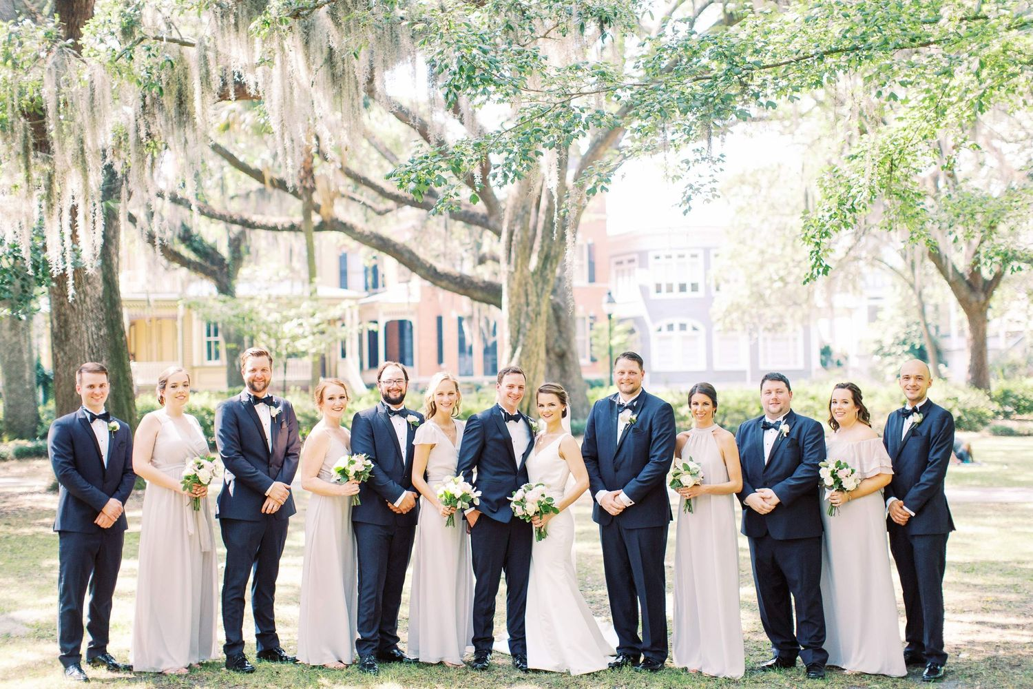 wedding party poses in forsyth park found in downtown savannah ga
