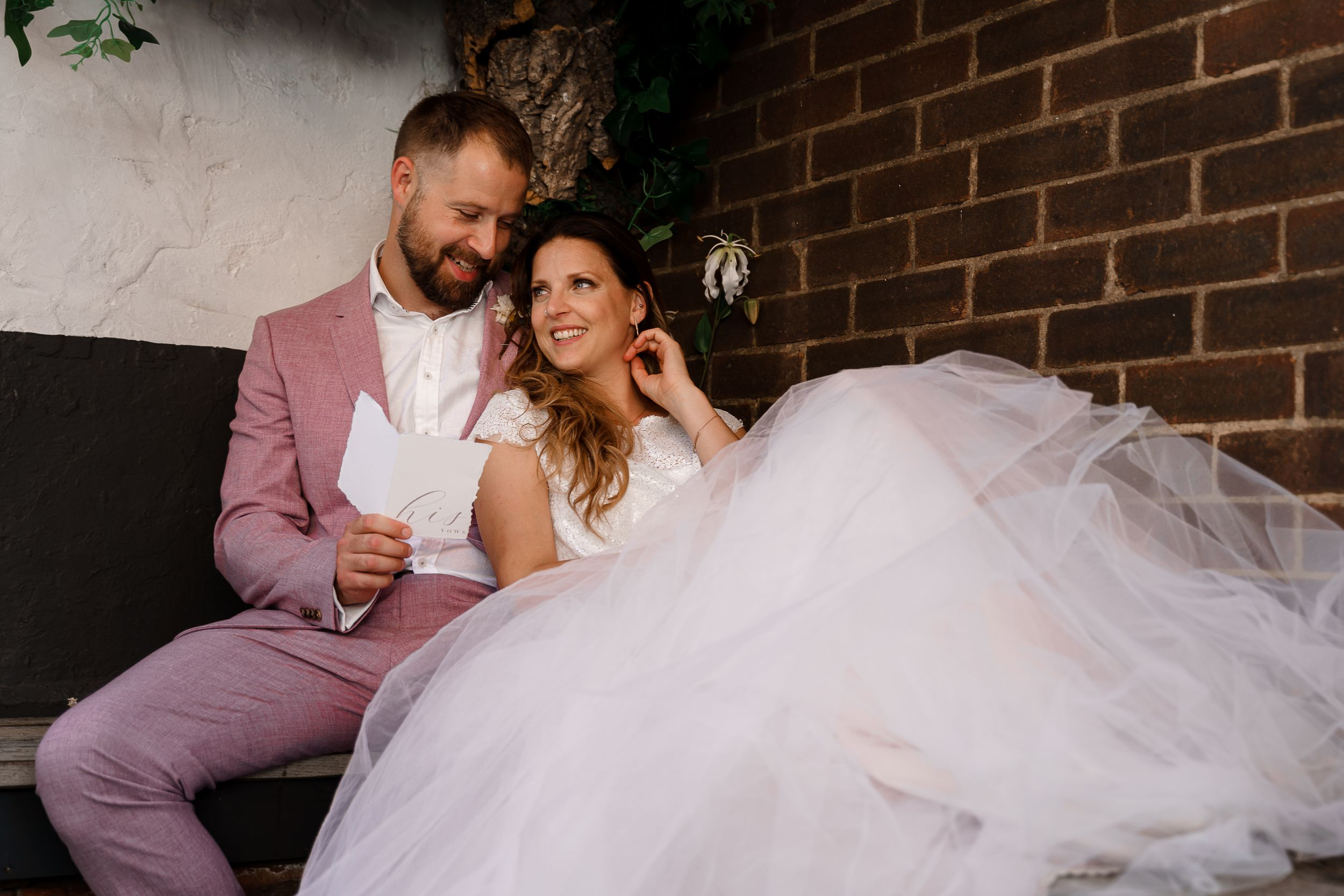 A newlywed couple read vows to each other - introvert's guide to wedding photography.