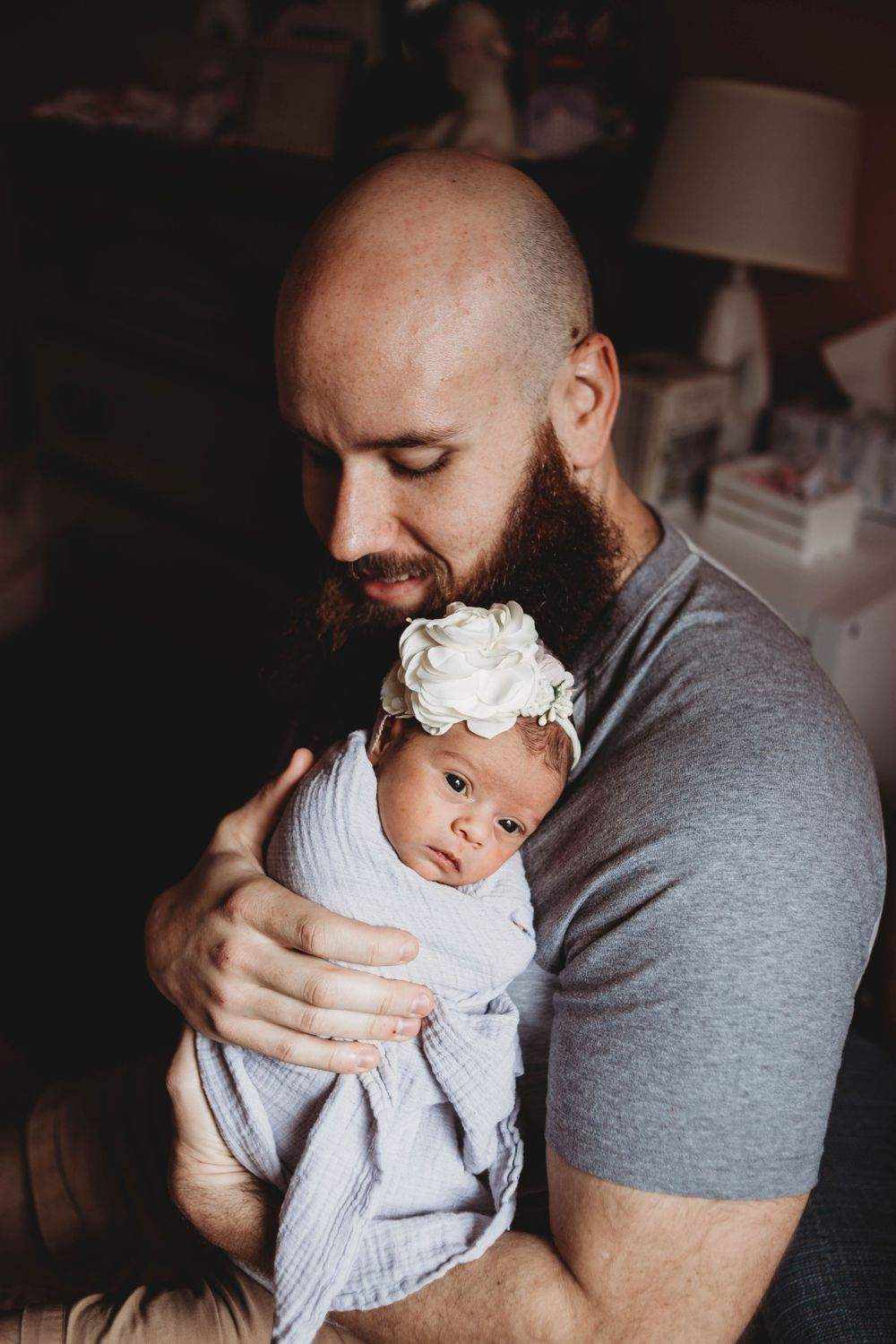 dad holding his baby by boston newborn photographer