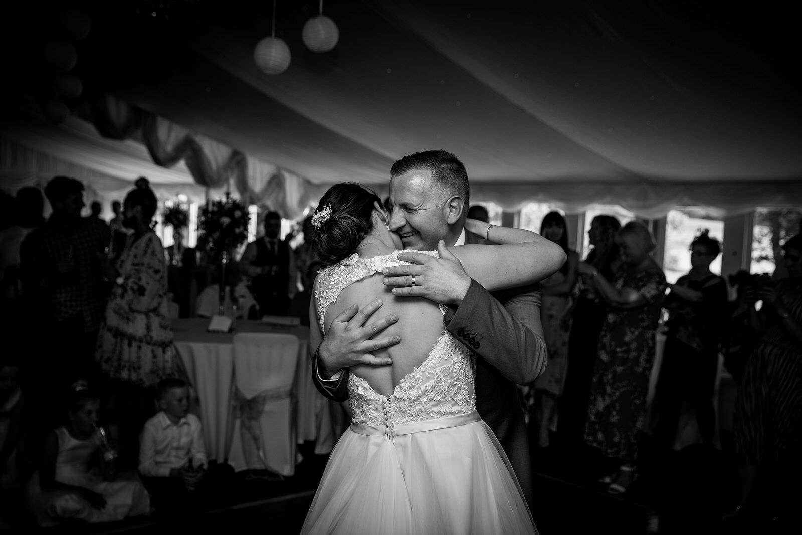 Bride & Groom laughing doing their first dance at The Old School House