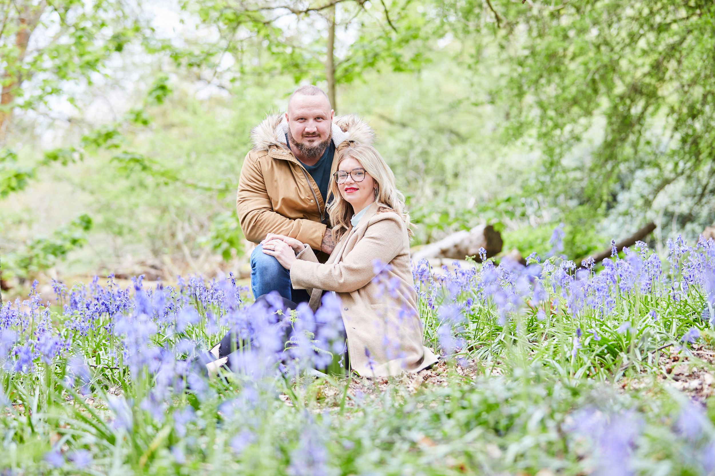 couple playing in bluebells