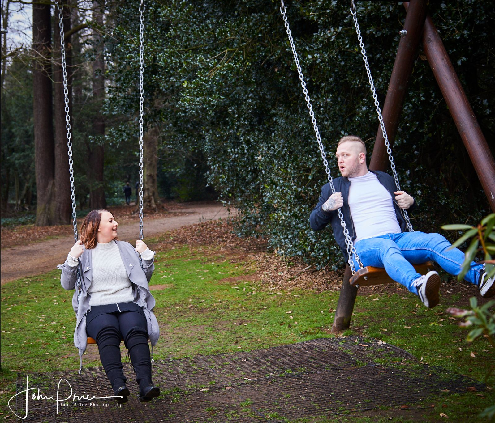 engaged couple fun photo on swings