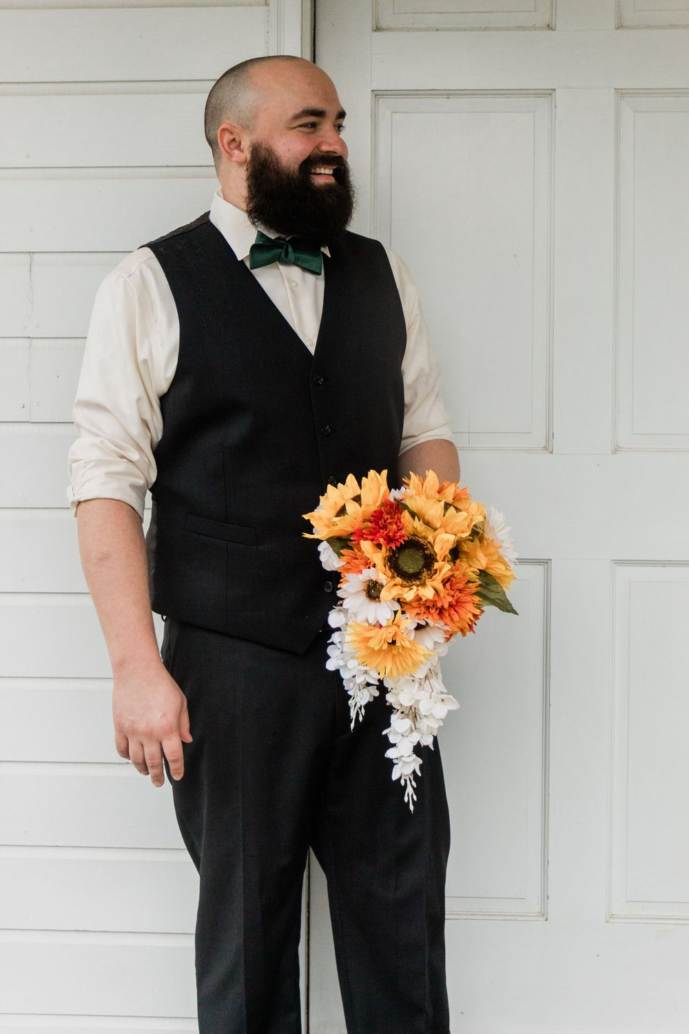Groom holding bouquet wedding day portraits Bowdon GA 2020 Wedding