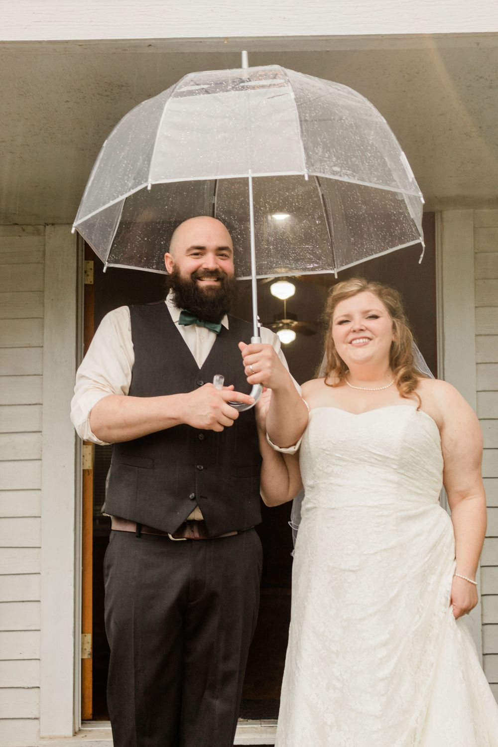 Rainy wedding day portraits with clear umbrella Bowdon, GA 2020 Wedding