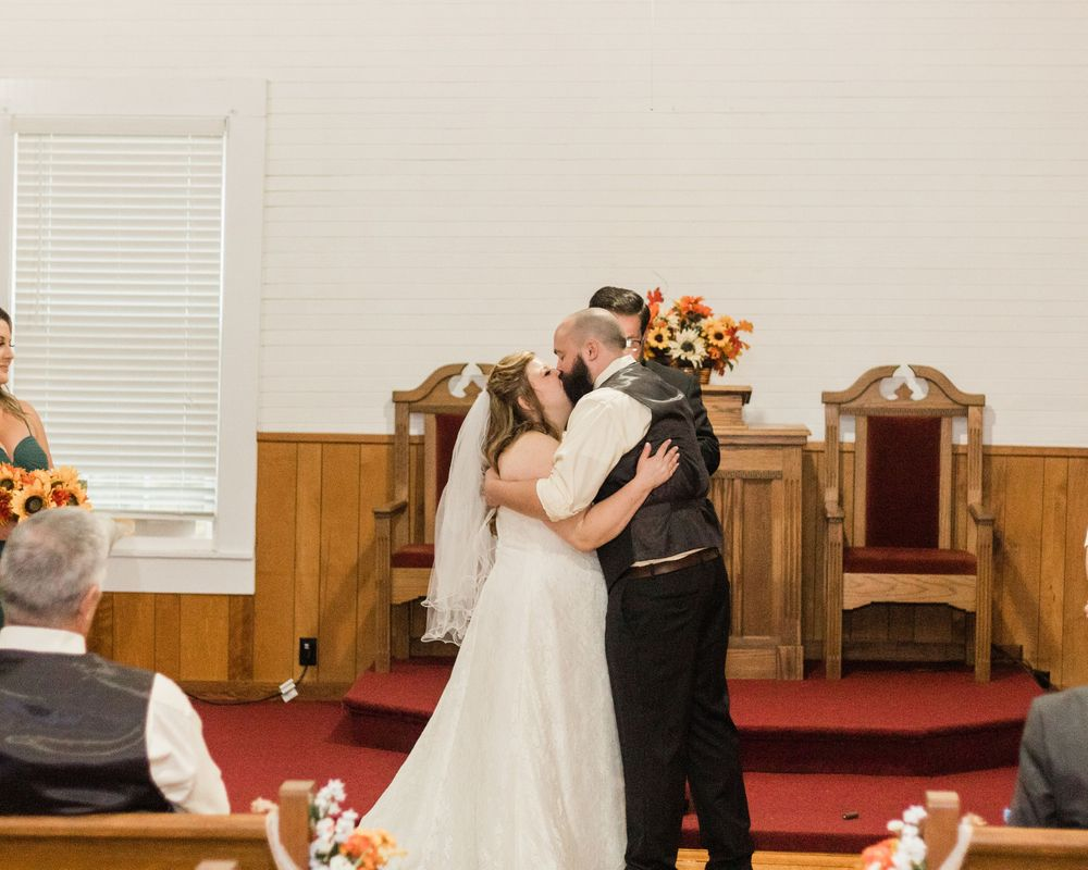 Bride and groom kissing church wedding Bowdon, GA 2020 Wedding
