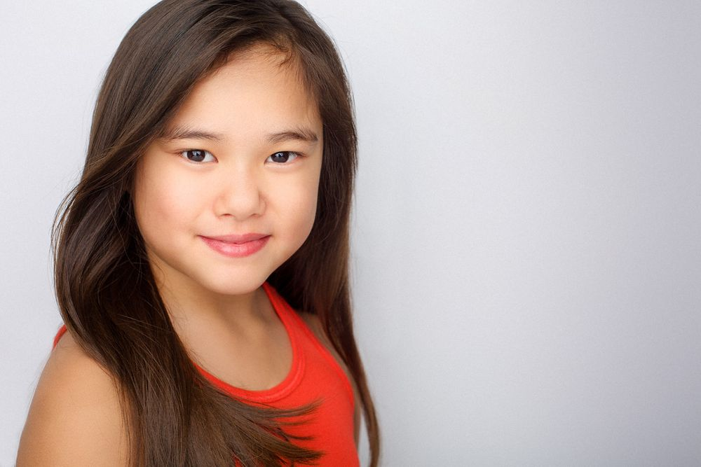 headshots nyc of kid actor in red top