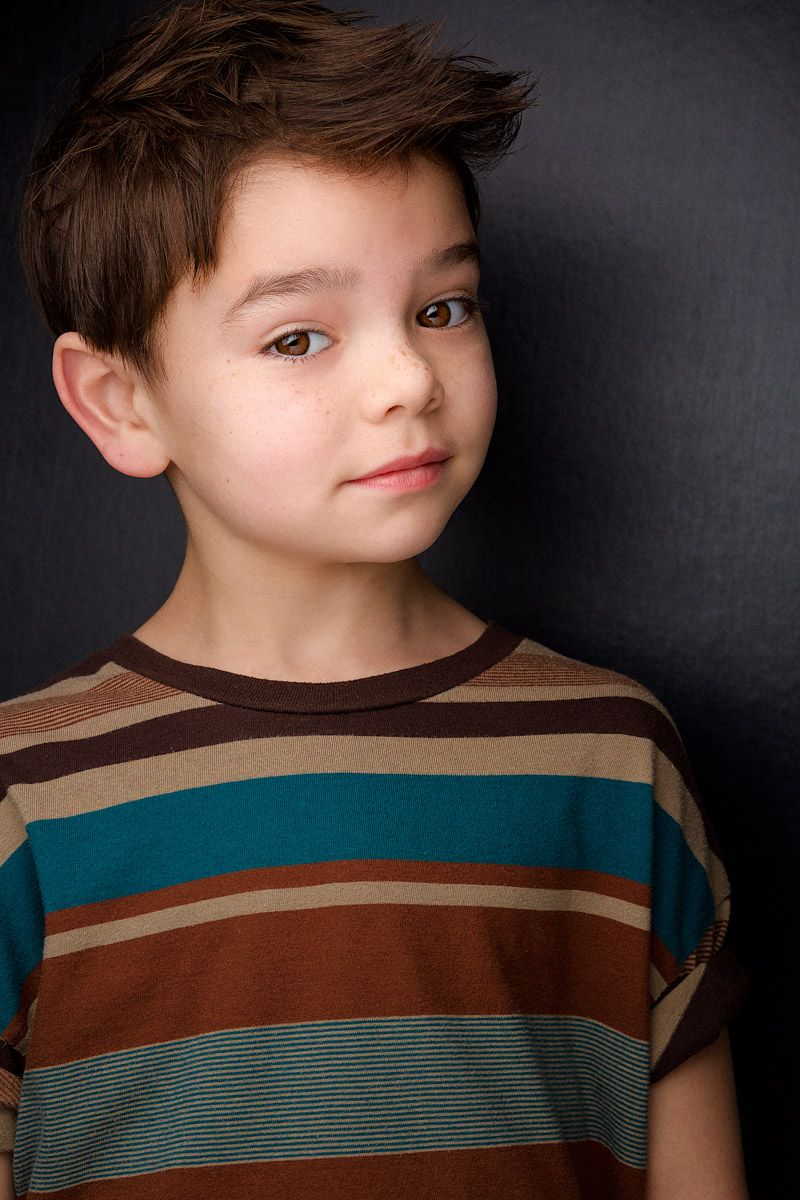 headshots nyc of brunette kid with freckles in striped shirt