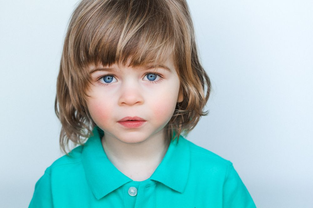 headshots nyc of adorable kid actor with blue eyes