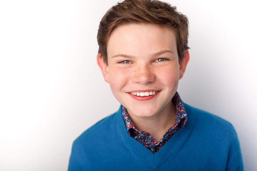 headshots nyc of kid actor timothy foley smiling
