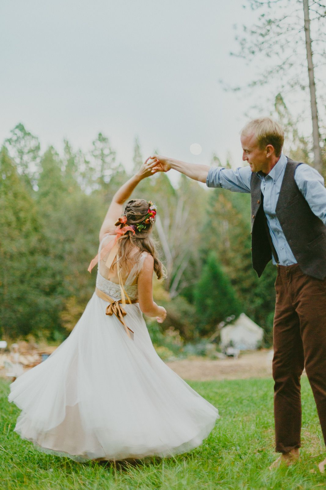 wedding couple dance in the grass in nevada city, nevada county.