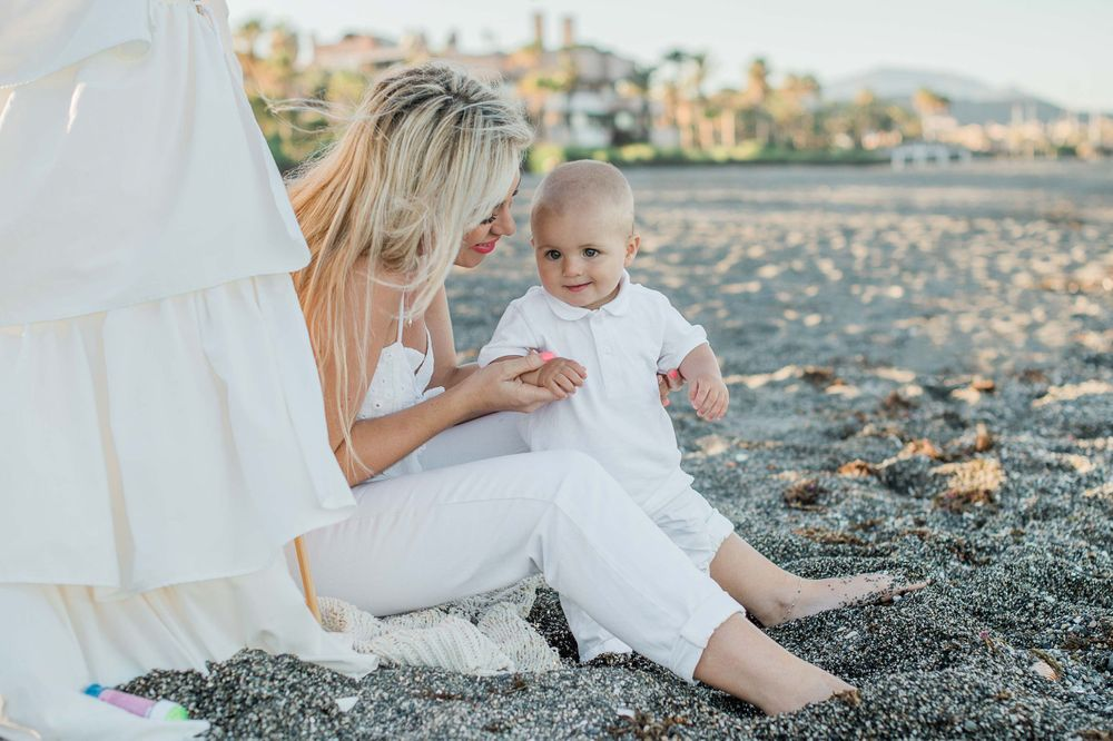 Portrait of a mother and a baby boy on the beach in Sotogrande