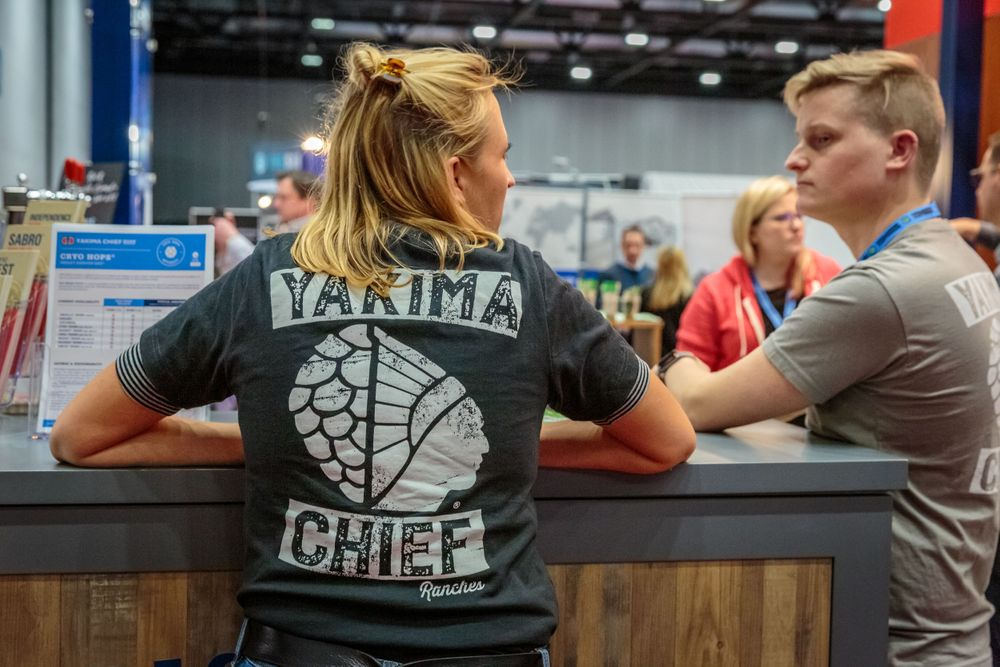 staff member wearing a yakima chief t shirt on the trade stand