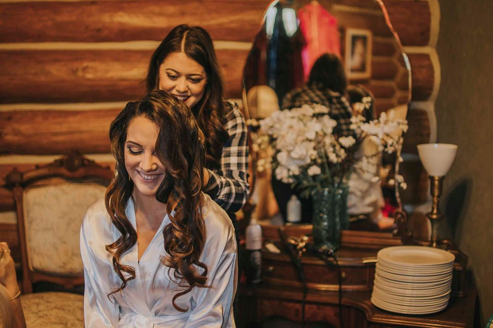 rebecca skidgel photography placerville winter wedding bride getting ready laughing