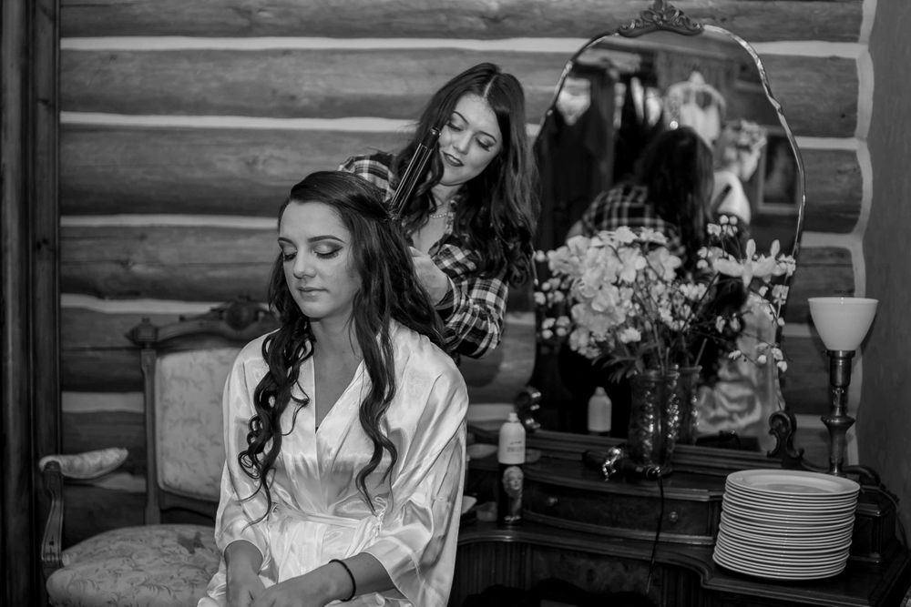 rebecca skidgel photography placerville winter wedding bride getting ready hair and makeup