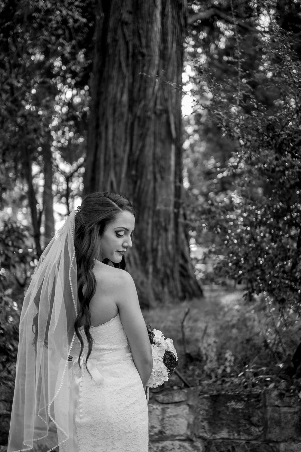 rebecca skidgel photography placerville winter wedding pretty lighting bride smiling and looking down over shoulder