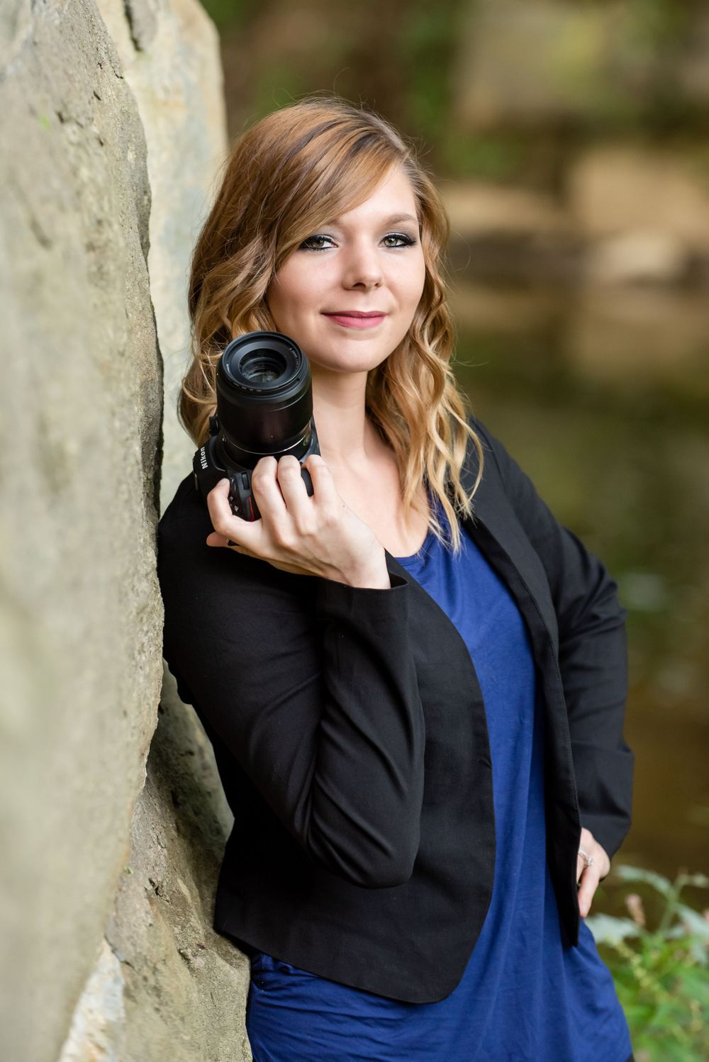 Portraits by Athena, business picture with her camera