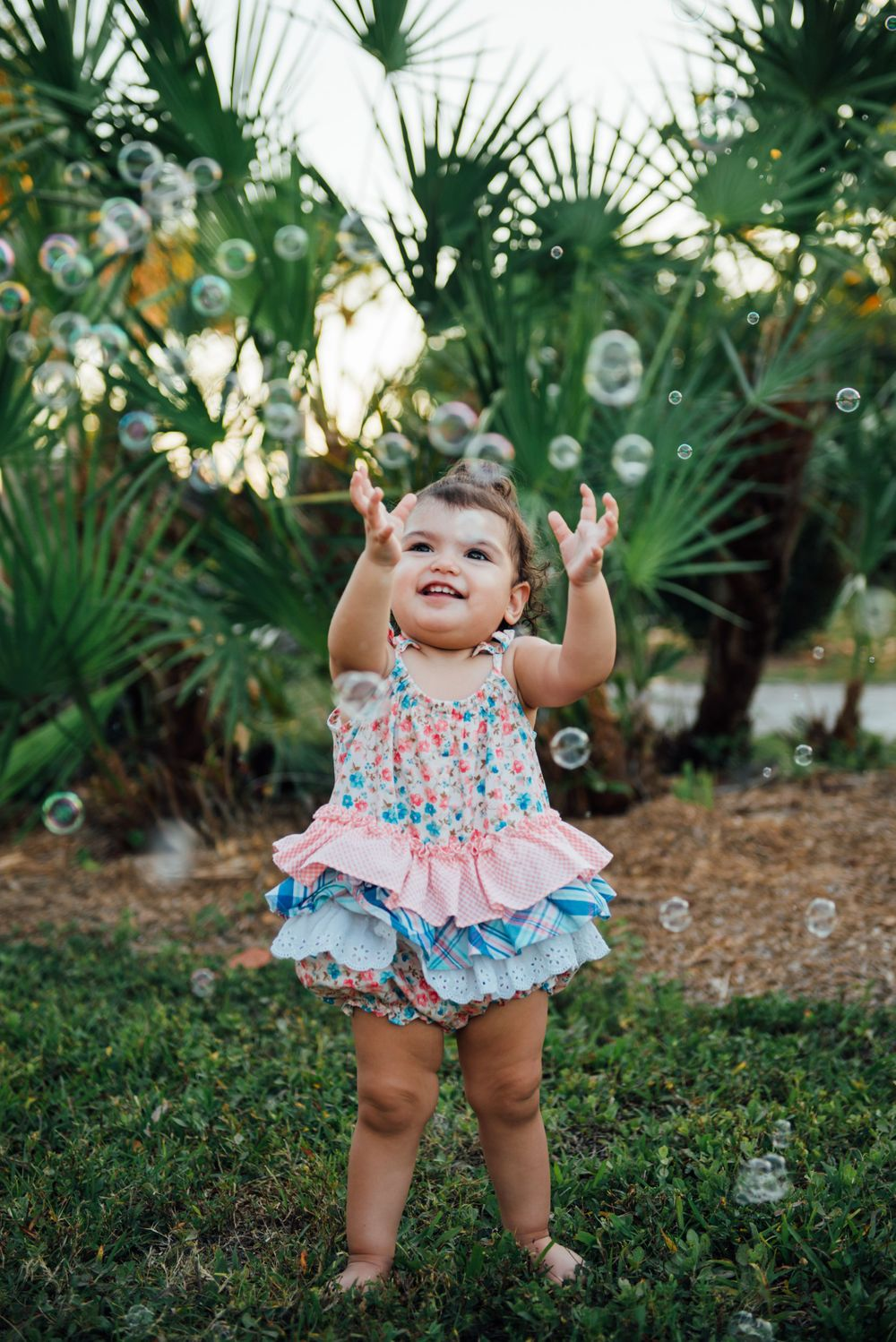 child photo session with bubbles on fort myers beach
