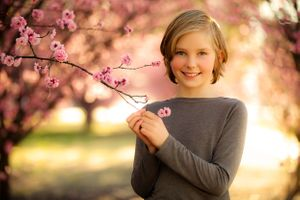 Victoria's Models junior headshot with cherry blossoms at Harrison School in Canberra