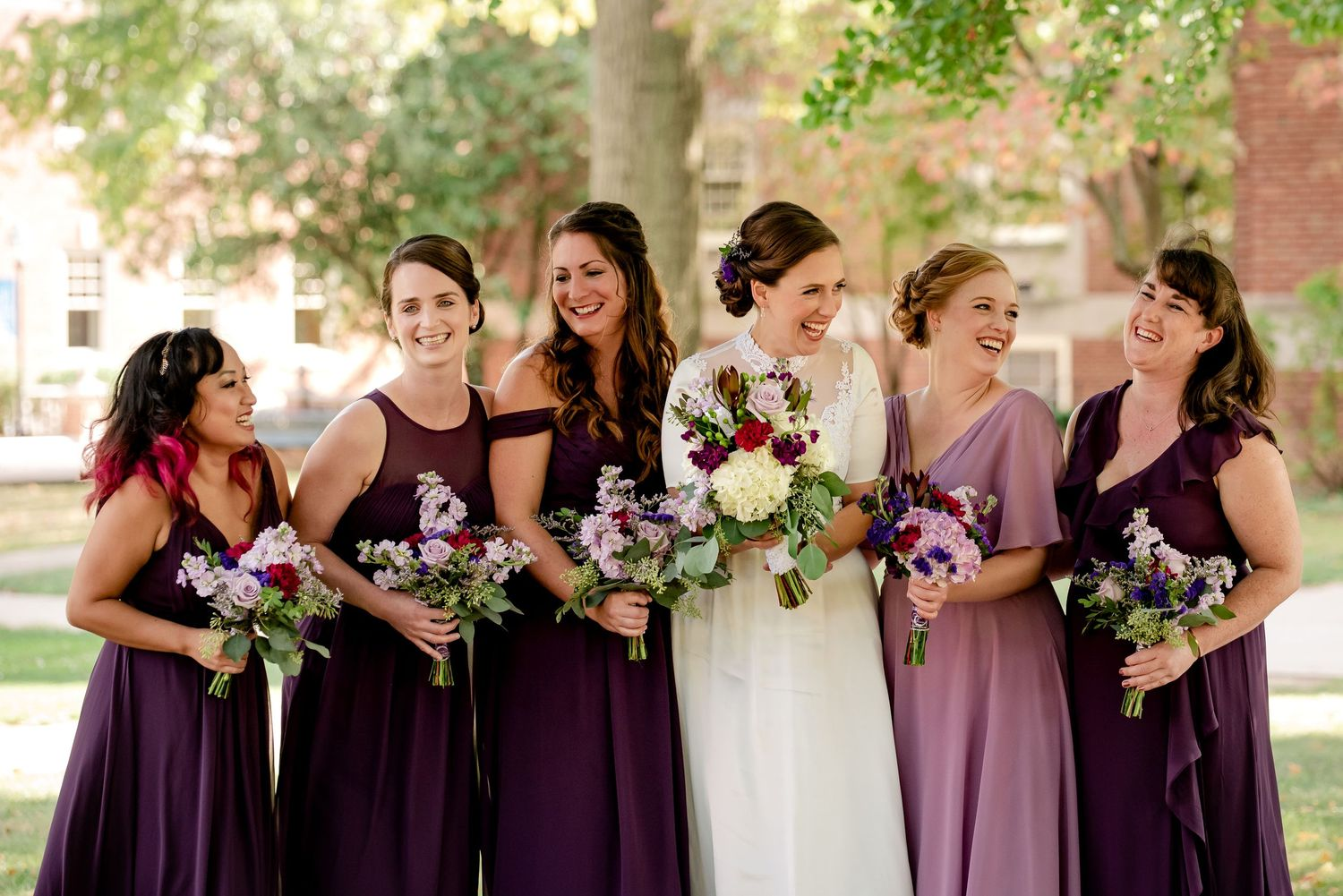 bridal party with bridesmaids laughing wearing marroon and purple in pittsburgh fall wedding