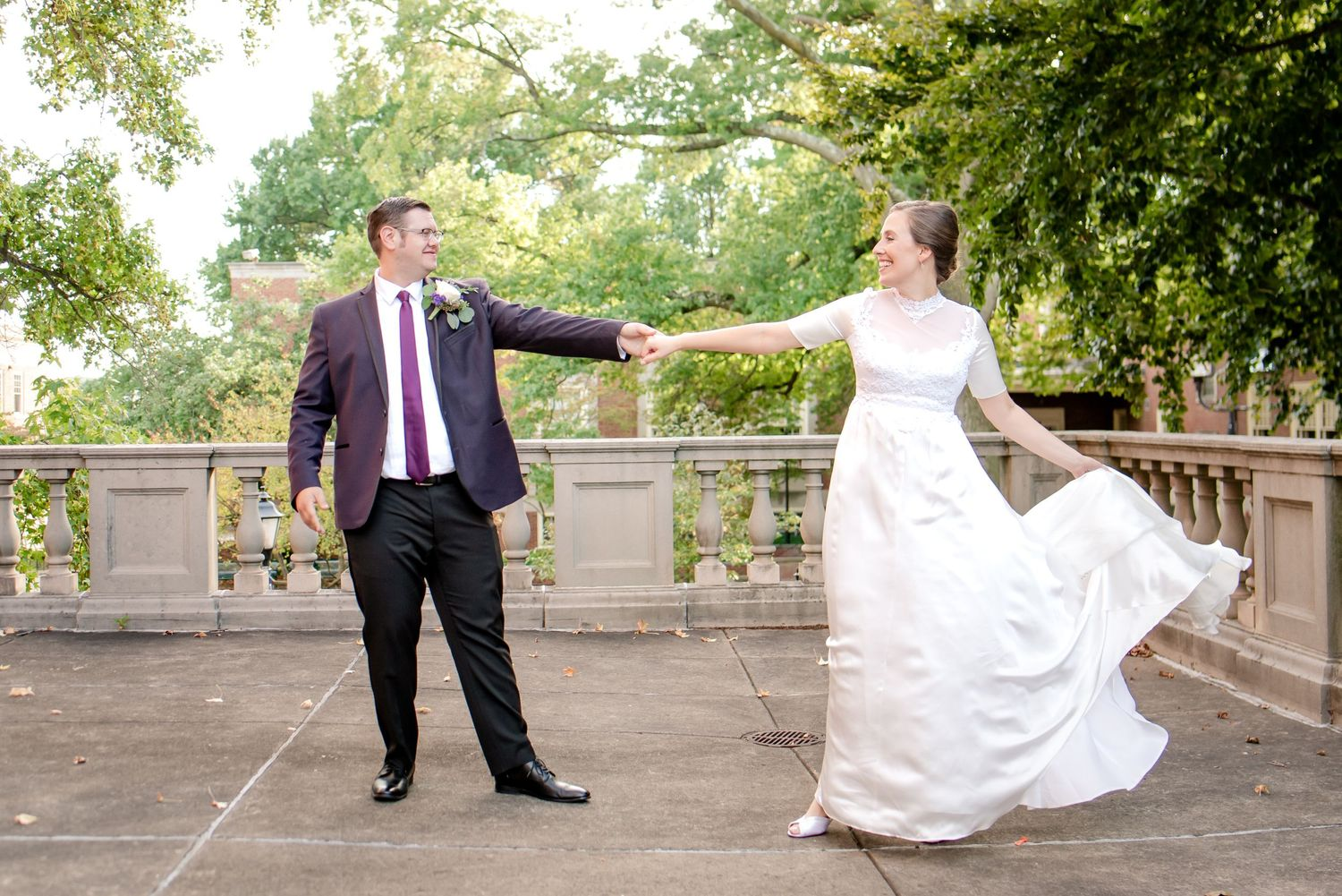 fall wedding in pittsburgh with bride and groom outside of church dancing