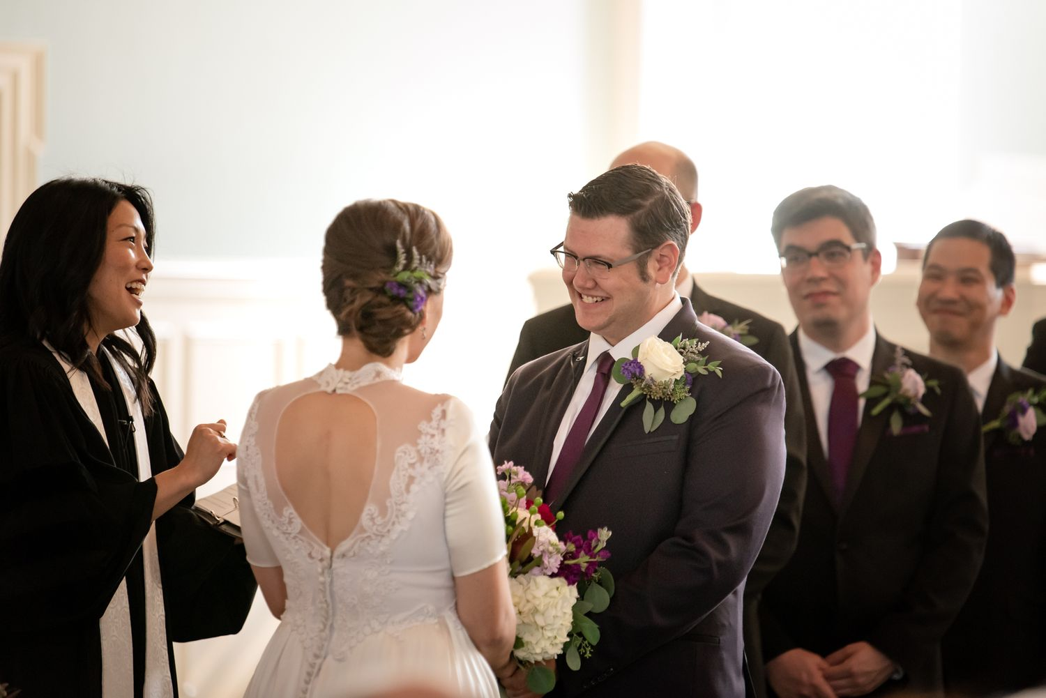 pittsburgh wedding groom and bride at end of aisle with grom smiling and groomsmen looking at couple
